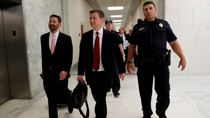 FBI agent Peter Strzok walks to a classified meeting after being interviewed all day before the House Judiciary Committee in Washington
